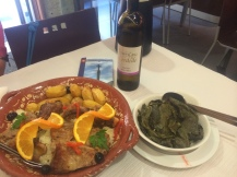 A delicious roast lamb with a bottle of Alvarinho