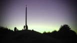 Sunrise behind the Cruz de Ferro