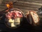 Aperol spritz and local cheese and hams