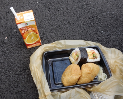 Sushi and orange juice from a convenience store for lunch