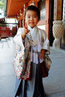 A 3 year old boy all dressed up at Imabari Castle for the 'Shichi go san' festival