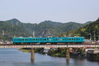 Small train crossing a bridge over the Kozagawa river, Ohechi route