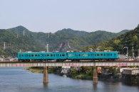 Small train crossing a bridge over the Kozagawa river, Ohechi route