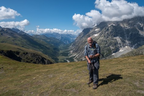 Dad at the Swiss/Italian border on top of the Grand Col Ferret with Italy in the background