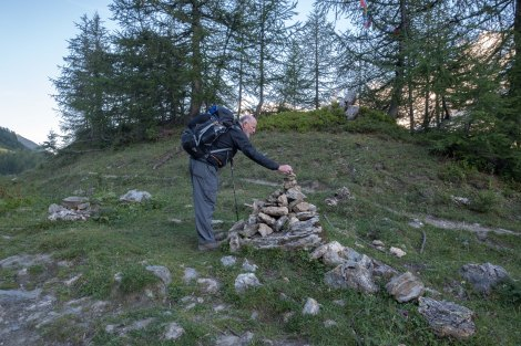 Dad placing a stone on a cairn, hopefully he's asking for good weather for the hike!