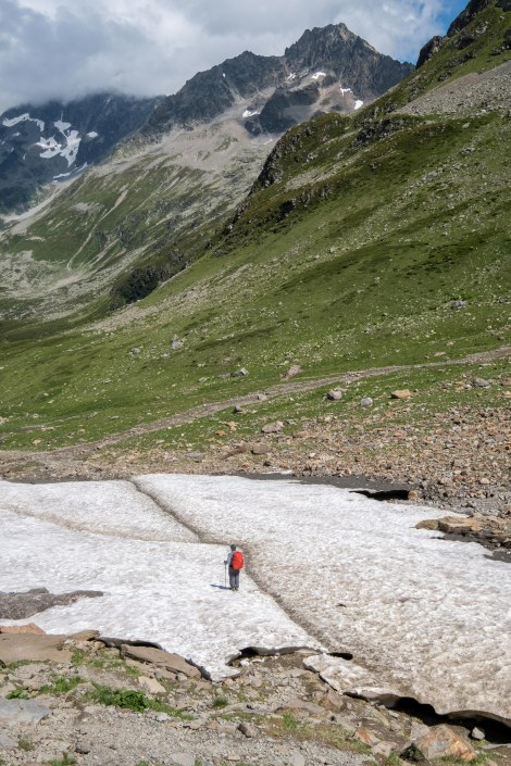 Descending through a snow field from Col du Bonhomme