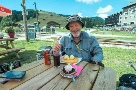 Dad about to tuck into a waffle at Col de Voza (1653m) with the Tramway du Mont Blanc line behind him