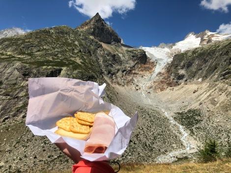 Lunch of ham, cheese and crackers near Rifugio Elena overlooking Glacier de Pre de Bar, Mont Dolent and Aiguille de Triolet