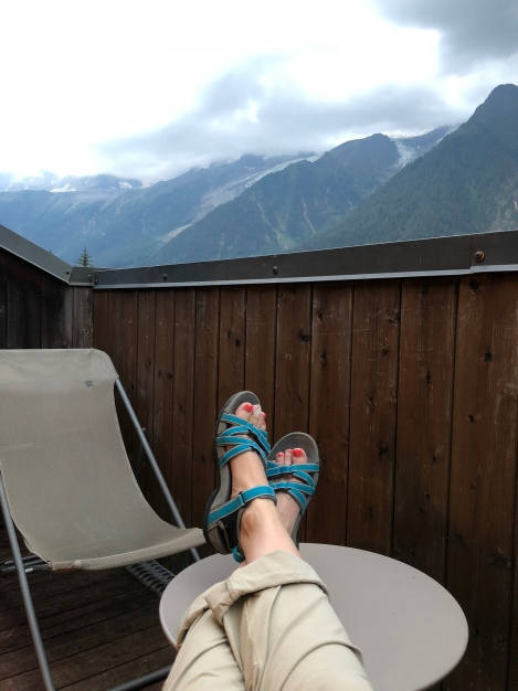 Relaxing on our balcony with a view of Mont Blanc (obscured by cloud in this photo) at Hotel Les Campanules