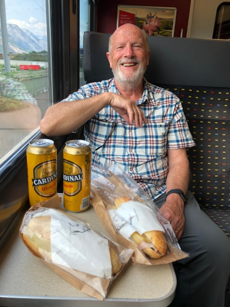 Celebrating on the train with baguettes and beer