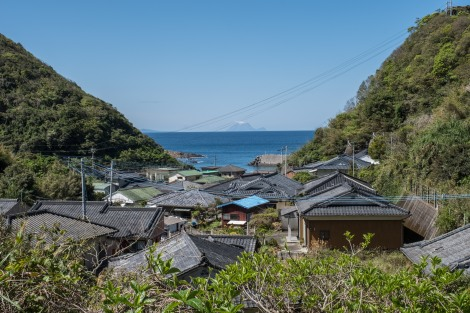 Local houses, sea and volcano views