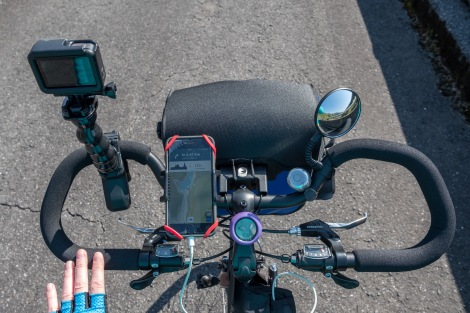 My handlebar set up with the GoPro and clamp, iPhone, trip computer, bell and mirror
