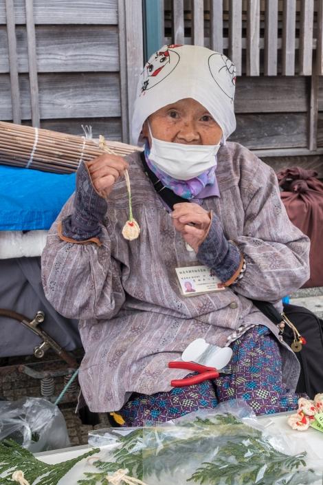 A lady selling her wares at the Wajima asaichi morning market