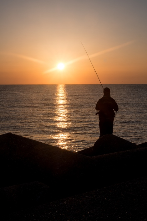 A fisherman at sunrise at Cape Rokko, Noto Peninsula