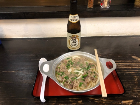 Dinner in Matsuyama of hot beef with udon noodles and a Kirin alcohol-free beer