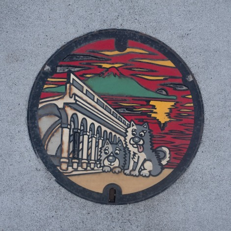 A Wakkanai manhole cover with Mt Rishiri in the background