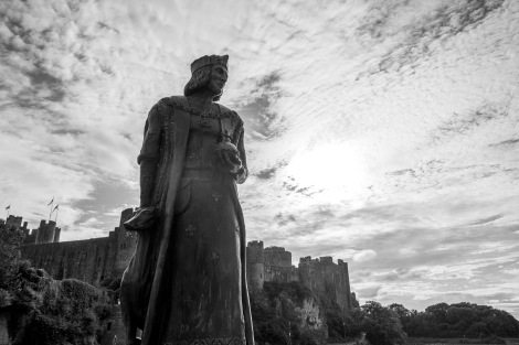 A statue of Henry VII in front of Pembroke Castle
