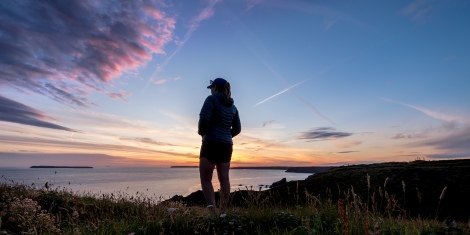 KC watching the sunset on day 4 of our Pembrokeshire Coast Path adventure