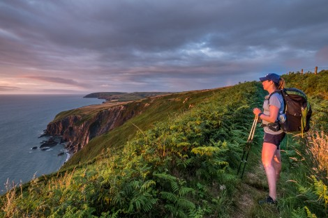 KC watching the sunset on the Pembrokeshire Coast Path