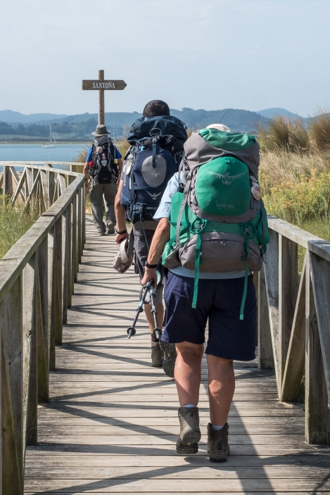 Pilgrims heading down the boardwalk to the boat across to Santoña