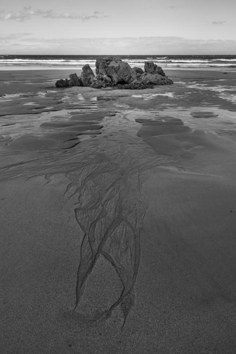 Sand, shapes and rocks at Playa de Penarronda