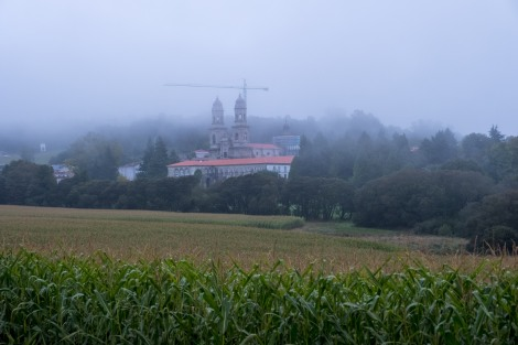 A misty morning view looking back at Monasterio de Sobrado