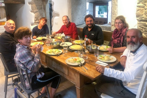 Enjoying the communal dinner at Albergue O Xistral in As Paredes-Castromaior