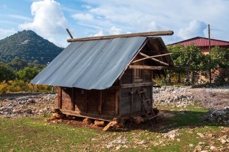 We pass a traditional grain hut in Belören
